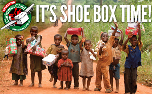 African Children hold up thier christmas shoe box from Operation Christmas Child